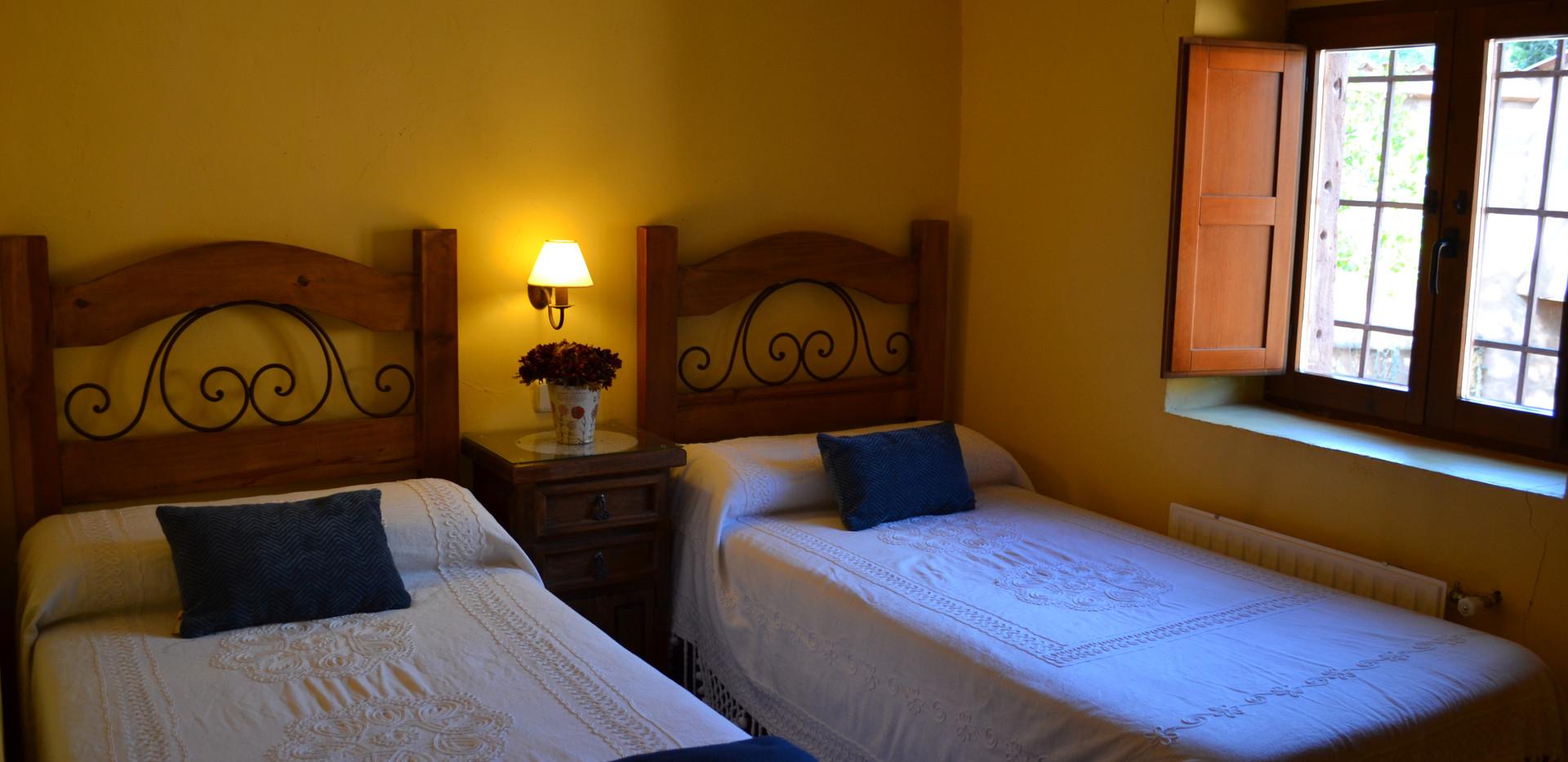 Zona con 2 camas del dormitorio 2