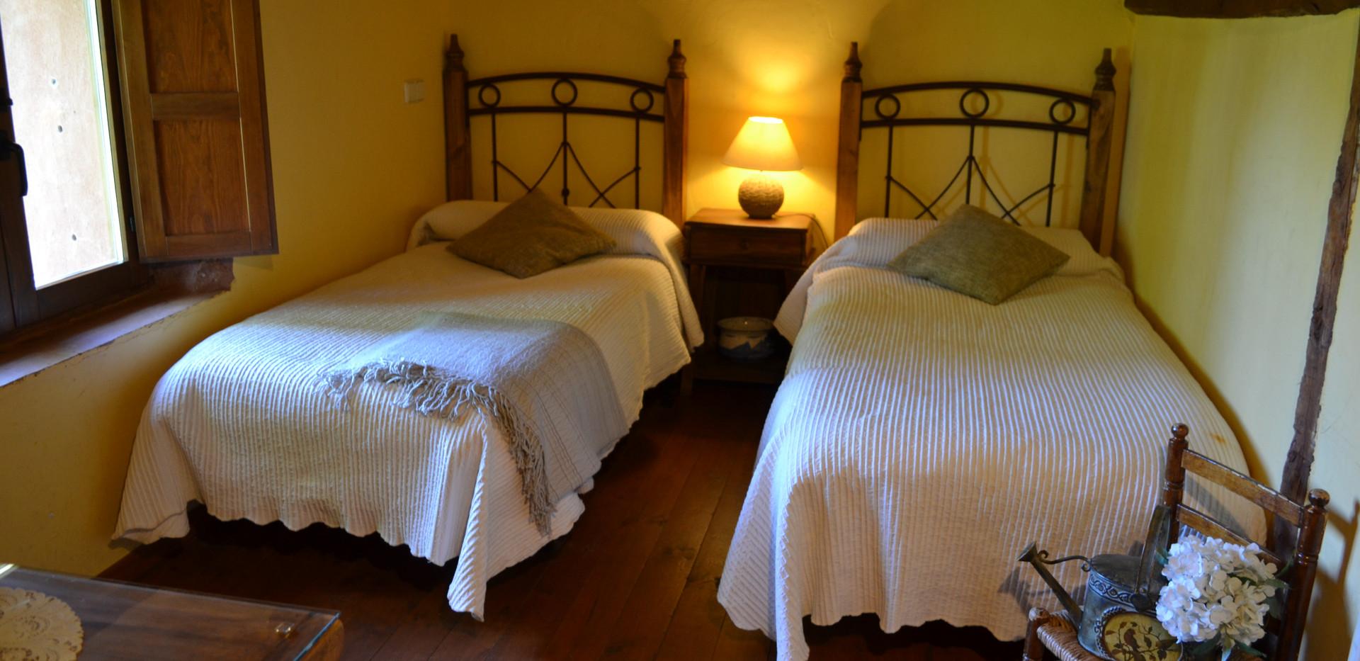 Zona con 2 camas del dormitorio 1