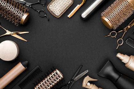 Hairdresser tools on black background with copy space in center.jpg