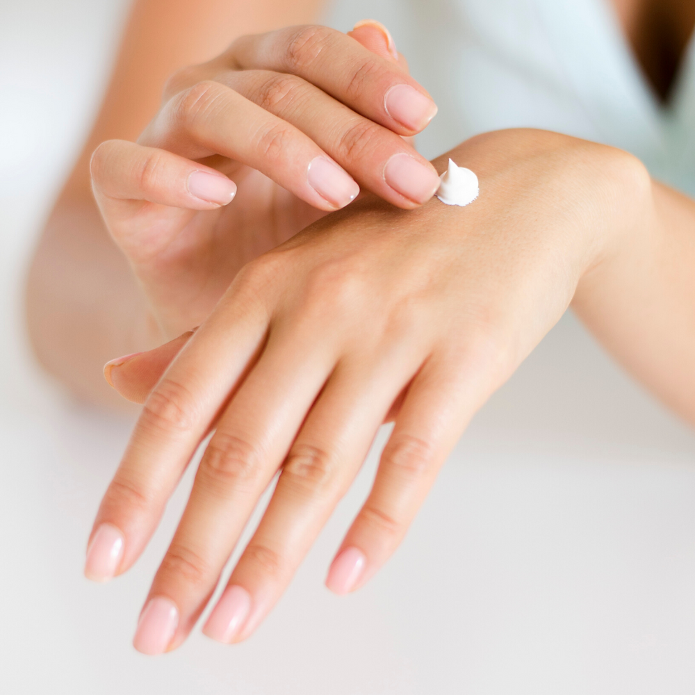 hands-hand cream-beautiful polished nails-pale nail polish-soft hand skin-healthy nails