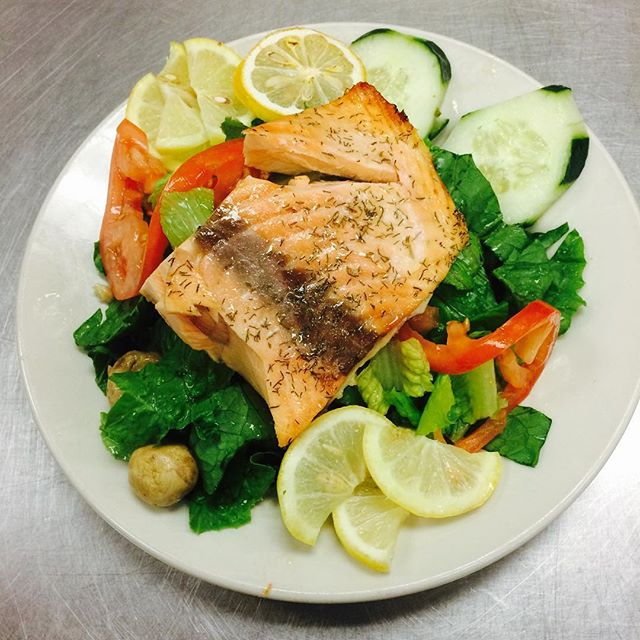 Salmon on a bed of greens $7