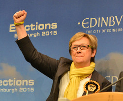 NEW SNP MP for Edinburgh South West Joanna Cherry waves to her supporters after her historic victory