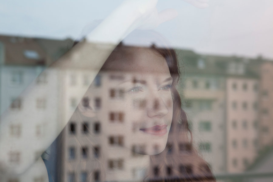 Woman Looking Out the Window
