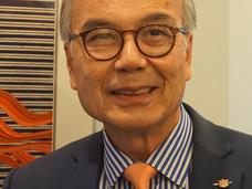 贸易厅长周烱华: 中国贸易、个人成功以及新移民融入