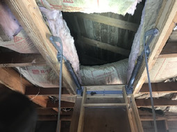 BAD DIY job, 3 ceiling joists were cut in order to install this attic access staircase. The ceiling structure has been compromised. These pulldown staircases are built to be installed parallel to the joists, not perpendicular.
