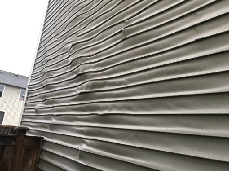 Cheap vinyl siding didnt hold up to the UV rays