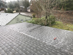Lower roof section is 2/12 pitch. This requires rolled roofing, not shingles. Code violation