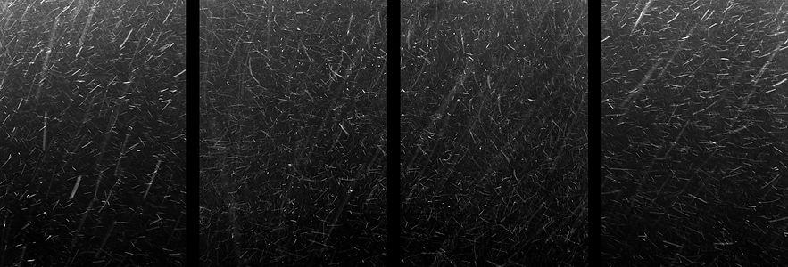 Snow flakes falling over the Sowa River, Oswiecim.  Oswiecim was renamed Auschwitz by the Nazis.
