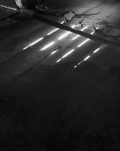 Shadows from one of the women's sleeping platforms, women's barrack, Birkenau.