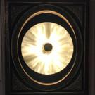 Applique cymbale sur cadre miroir Napoléon