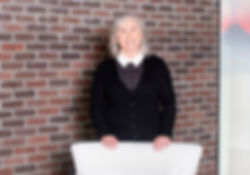 Female Executive Portrait With Brick Wal