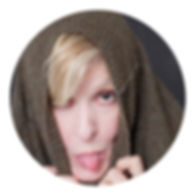 Headshot of woman sticking her tongue ou