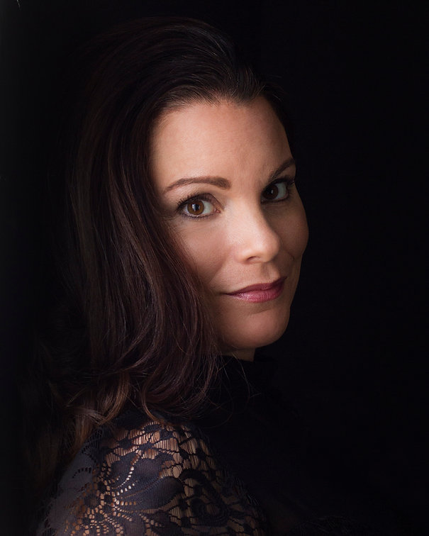 Headshot of creative women with dark bac