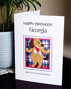 child's personalised birthday card with a happy dog on tartan