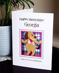 Dancing dog on a pink tartan back childs personalised birthday card