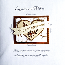 engagement card with beige/gold glitter hearts on rose gold backing