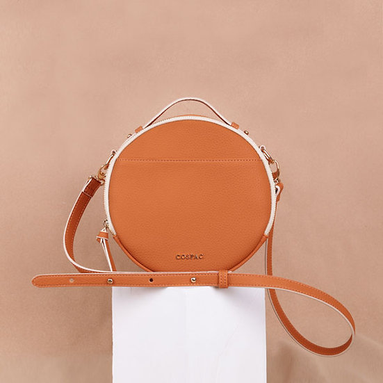 Brown color synthetic leather portable crossbody round bag
