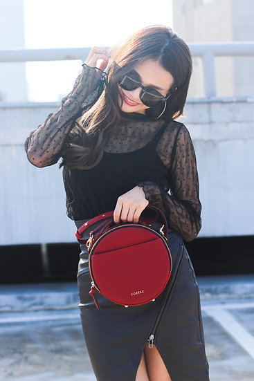 Red color synthetic leather portable crossbody round bag