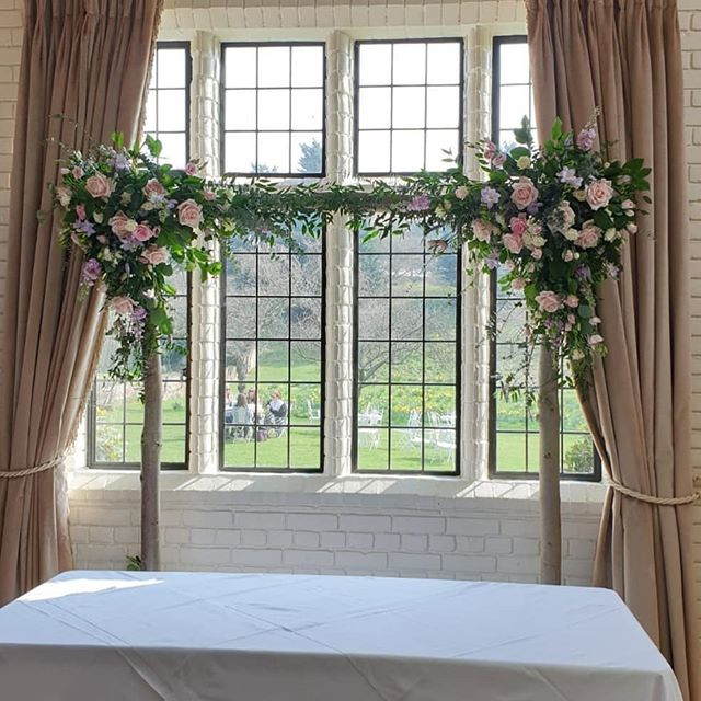 Rustic arch backdrop at Seckford Hall to