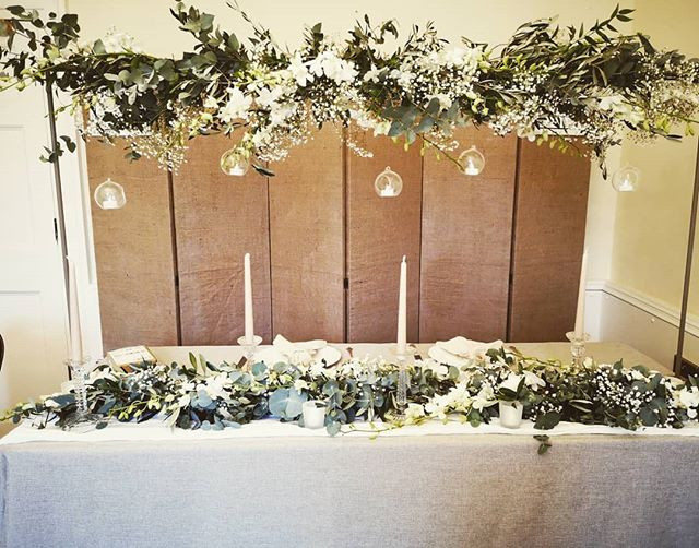 Top table canopy and garland at the Suff