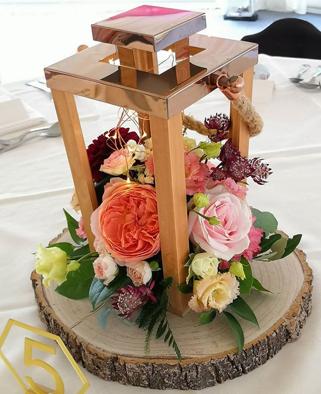 Rustic lantern table centres with beauti