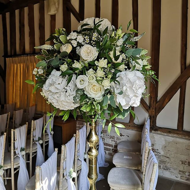 Tall gold candlestick white roses and hydrangea