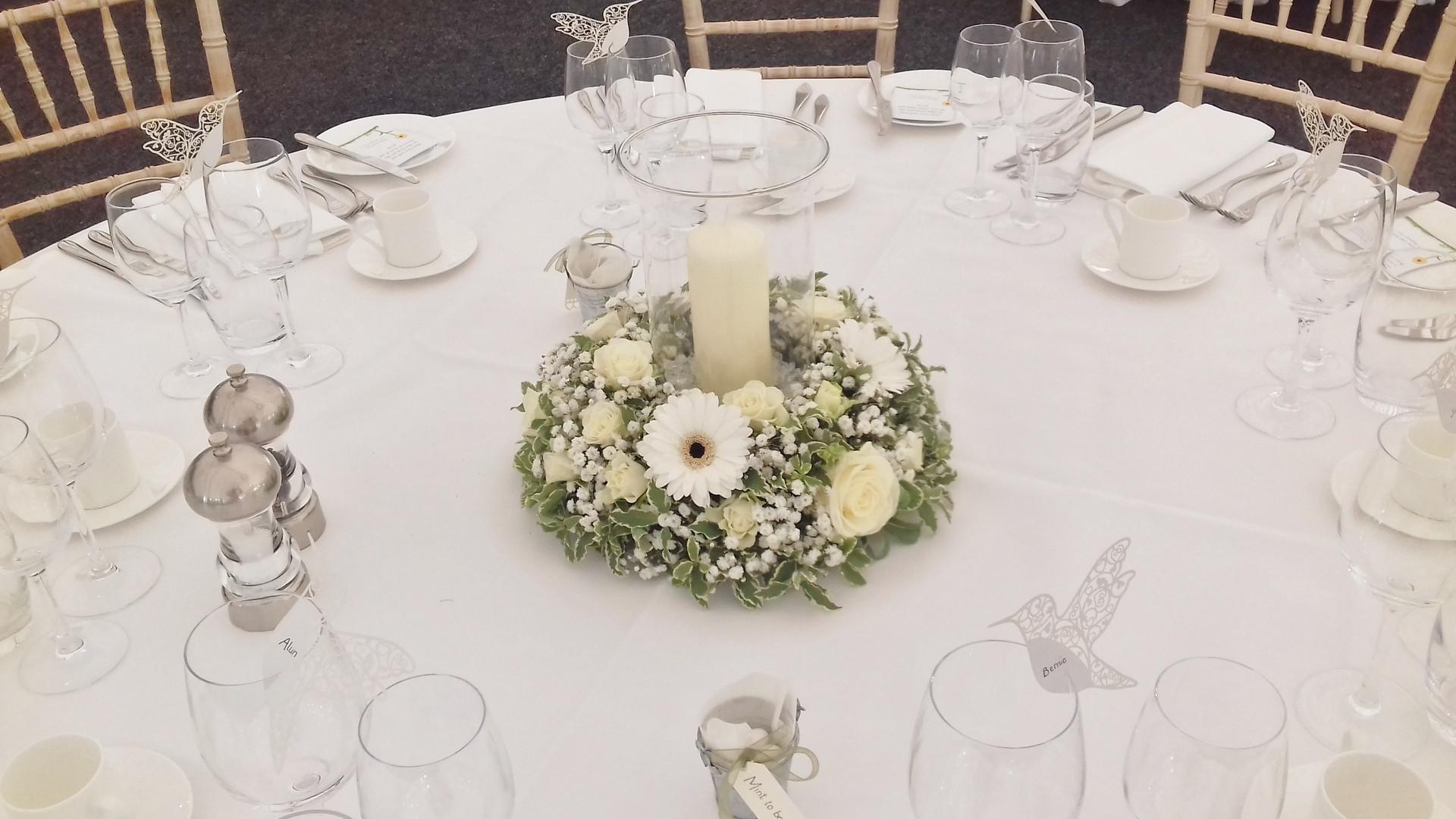Hurricane vase table centre