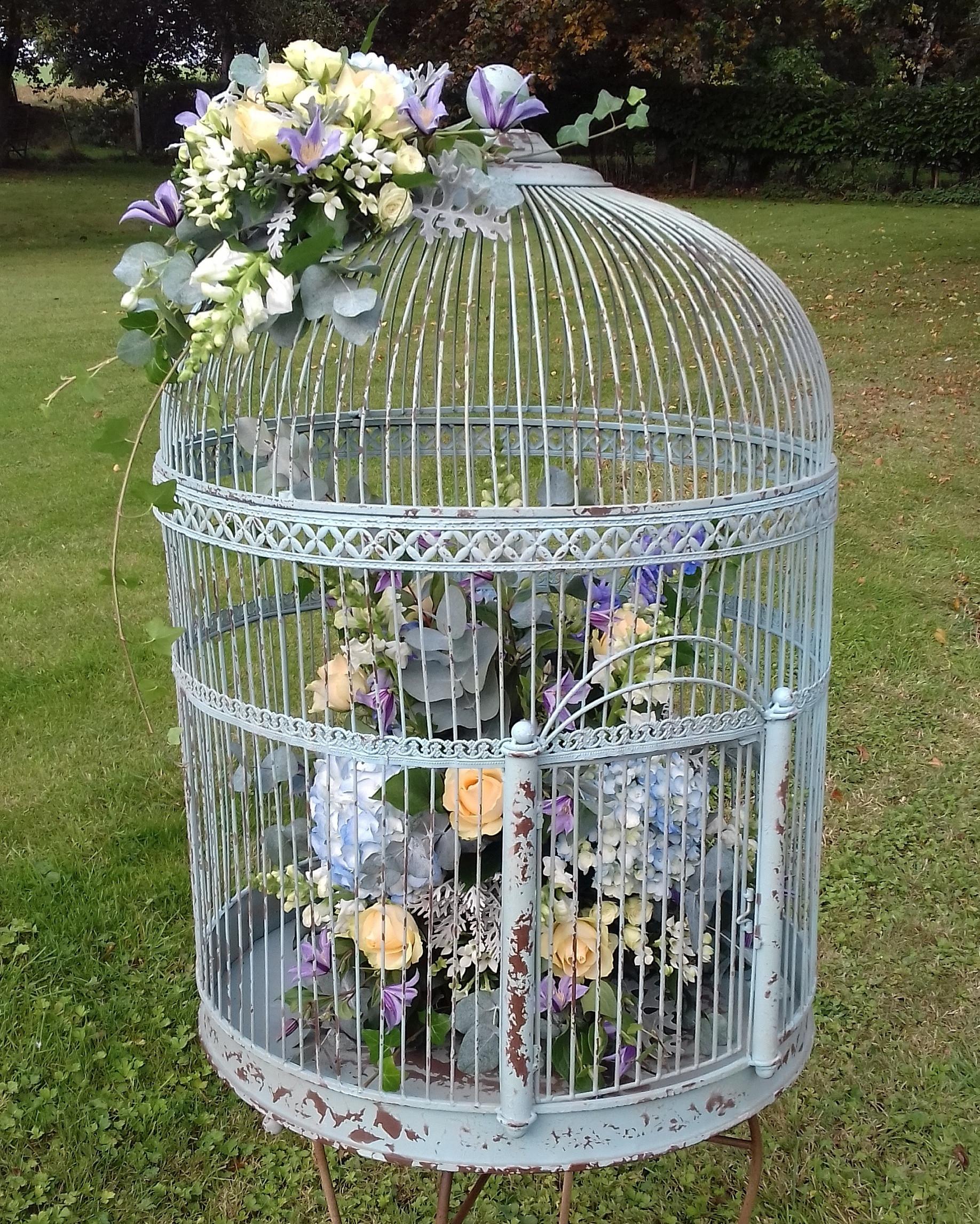 Huge birdcage wedding flower decoration