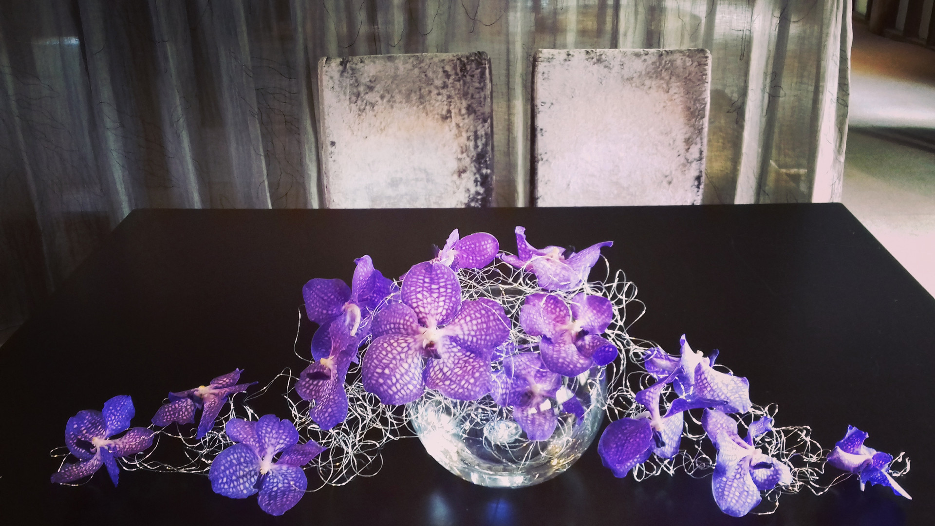Vanda orchid and wire top table
