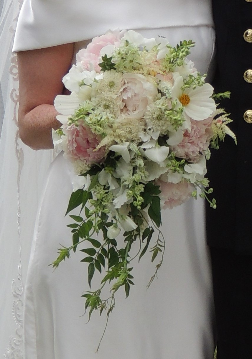 White and palerst pink trailing hand tie bridal bouquet