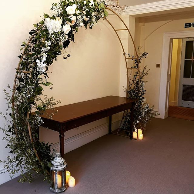Moongate arch with a casual, rustic fini