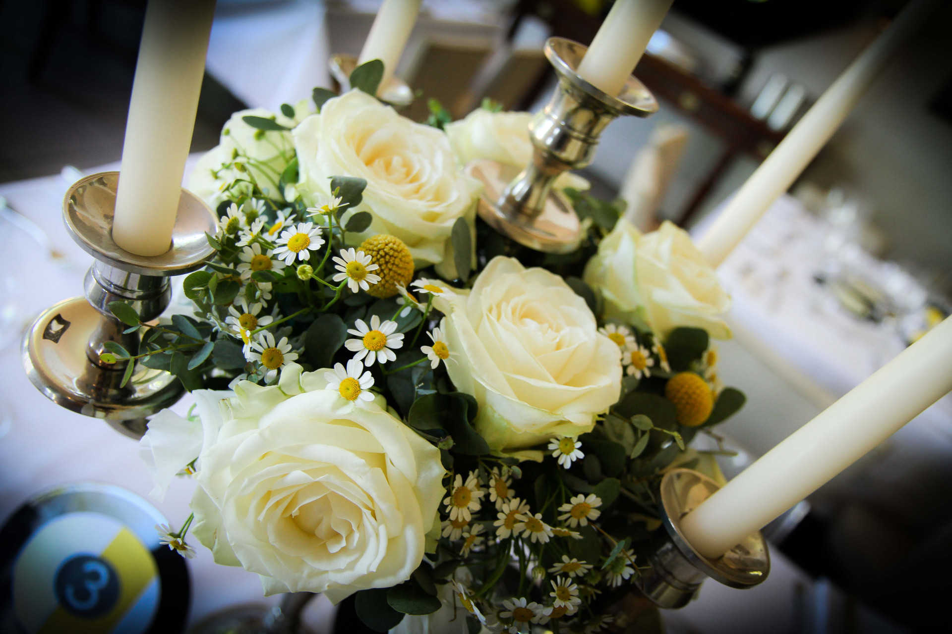 Candelabra ring of roses and daisies