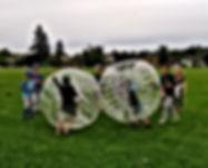 Kids playing bubble ball