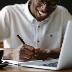 Canva - Man Writing Notes Sitting at a C