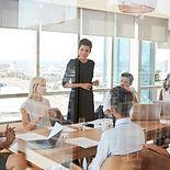 Canva - Businesswoman Leads Meeting arou