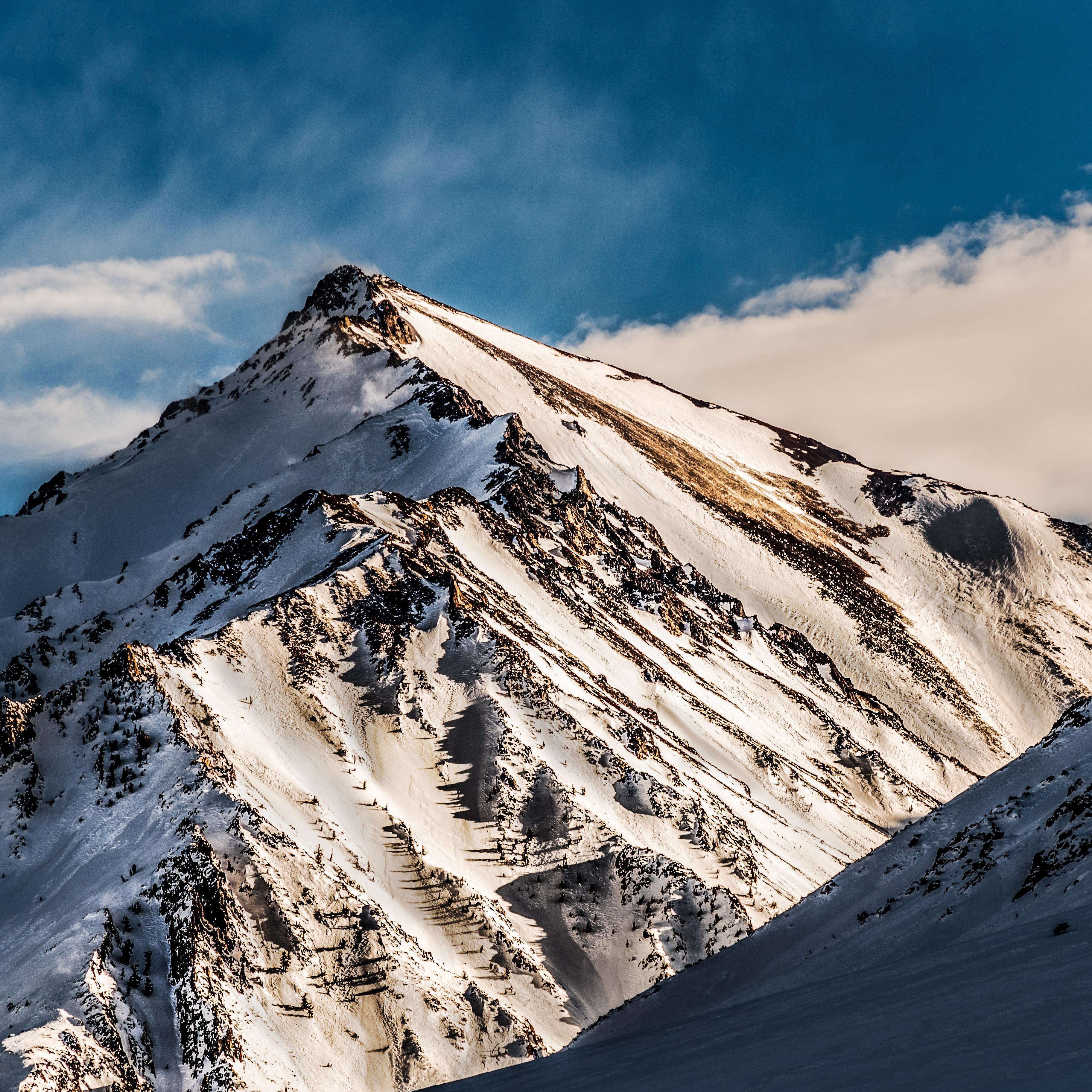 Canva - Snowy Mountain Peak