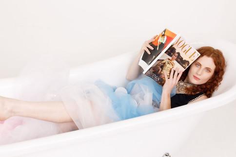 Model in bathtub with Vogue