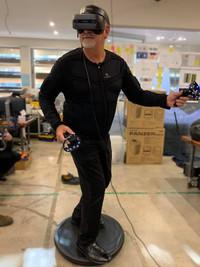 Ric Holland exploring Tesla Suit XR on Visospace Alto VR hoverboard. Extreme Digital Ventures