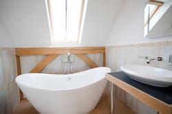 Slipper bath with shower