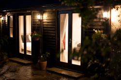 Cottage lit up at night