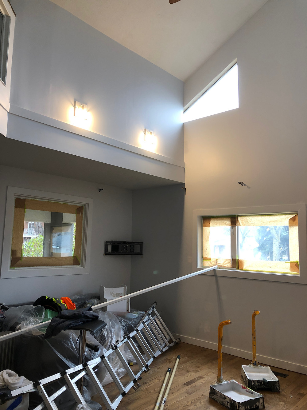 Preparation work for Mill Creek Painters painting contractors in a room with tall ceilings in Edmonton