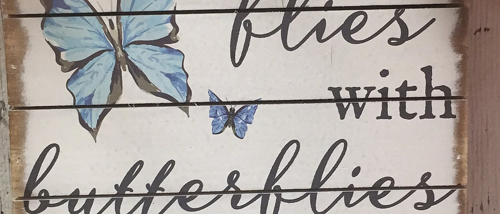 "6"" Now she flies with butterflies"