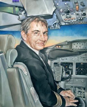 Portrait of a pilot in a 737 BBJ plane