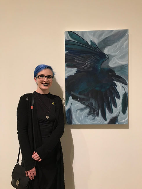 Standing with raven painting.JPEG