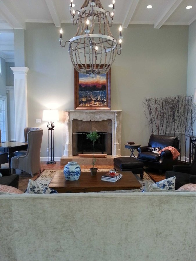 This rustic light fixture adds a relaxed feel to this living room.  Original art by Matt Colburn is the center piece.