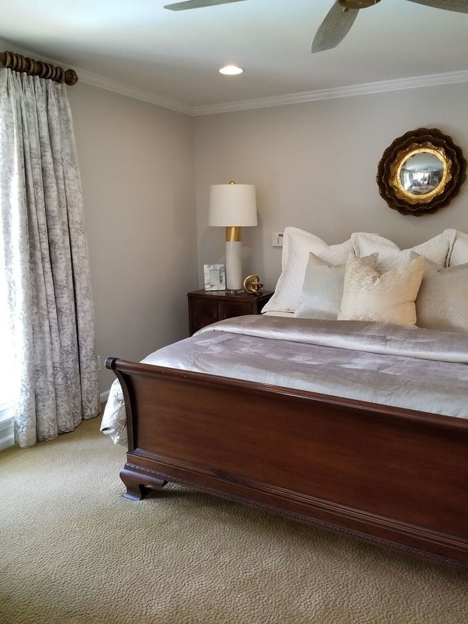 New bedding drapes and accessories update this classic Henredon furniture.