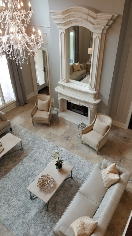 Grand precast fireplace is accented by a slightly darker wall.