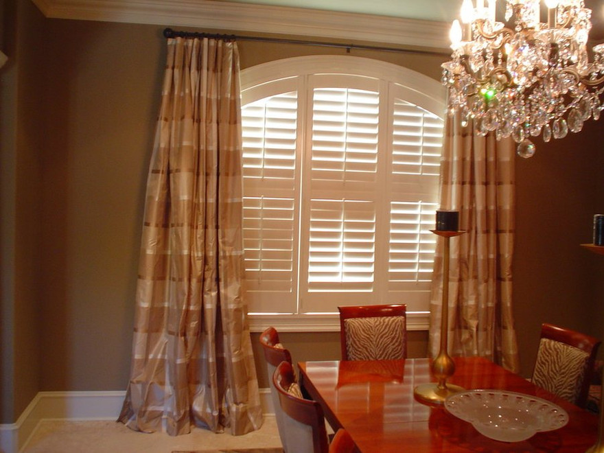 Silk custom drapes add softnes and elegance to this dining room.
