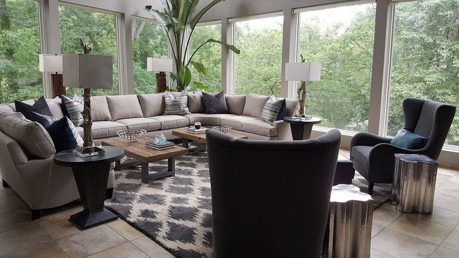This large sectional provides seating, while the two coffee tables allow your guests to move around freely.  Nature provides a beautiful backdrop.