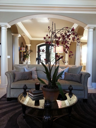 The arched entryway is a beautiful backdrop for this Hickory Chair sofa.